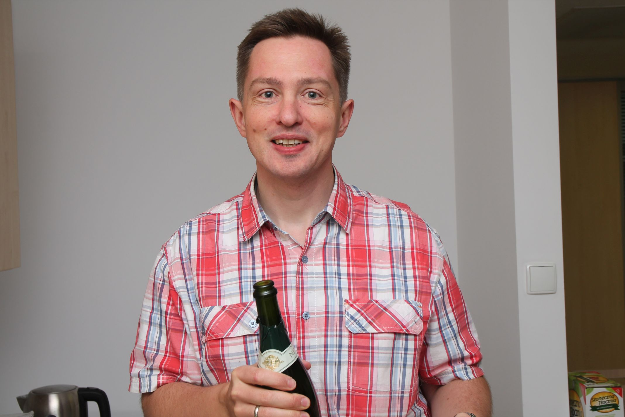 The host with a bottle of bubbly